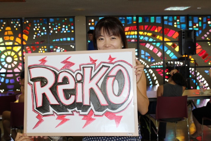 Harata proudly displays the sign that her friend made for her performance in the talent show