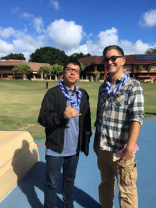 Alfie Gonzales and Sheldon Tawata pose in front of KCC's Great Lawn.