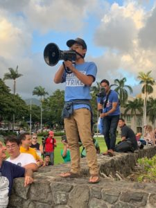 With megaphone in hand, Dyson Chee leads a climate strike.